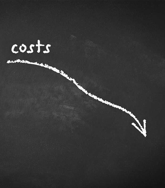 Chalkboard with illustration of costs decreasing